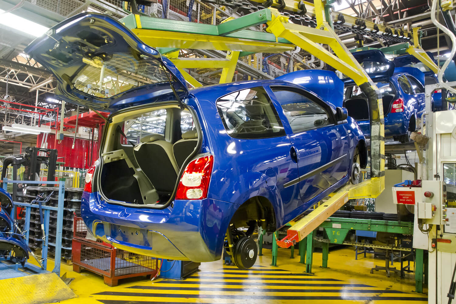 Photo of a car being manufactured in a production line